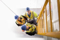 Apprentice builders learning how to climb ladders in training facility - CUF21818