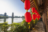 Red lanterns and the sun and moon pagodas at Shan lake in Guilin, Guangxi, China - CUF22013