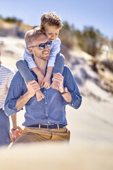 Happy father carrying son on shoulder at the beach - BEF00121