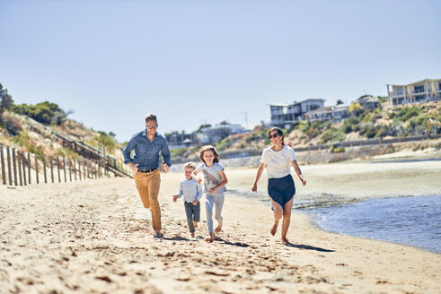 Australia, Adelaide, Onkaparinga River, happy family running on the beach together - BEF00124