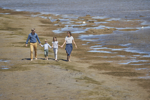 Australia, Adelaide, Onkaparinga River, happy family walking together hands in hands at beach - BEF00136