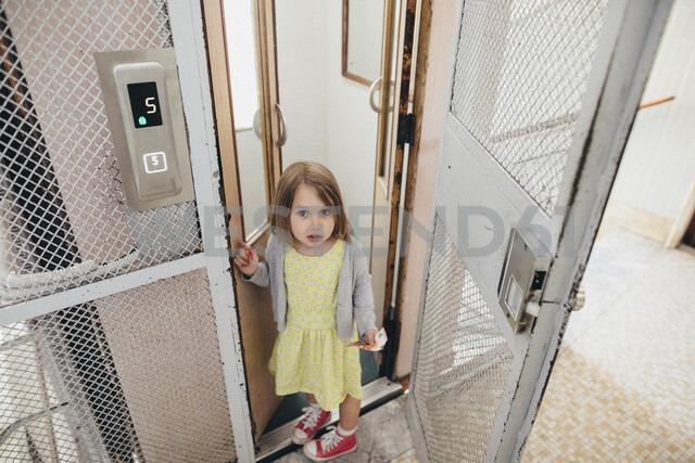 Portrait of little girl leaving lift - KMKF00250