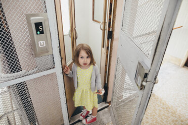 Portrait of little girl leaving lift - KMKF00250
