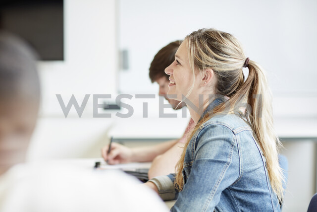Female student listening in higher education college classroom - CUF22193
