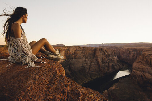Woman relaxing and enjoying view, Horseshoe Bend, Page, Arizona, USA - ISF08764
