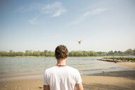 Man flying drone at a river - ONF01140