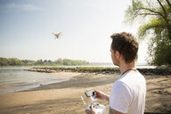 Man flying drone at a river - ONF01143