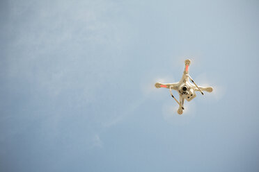 Drone flying in blue sky - ONF01149