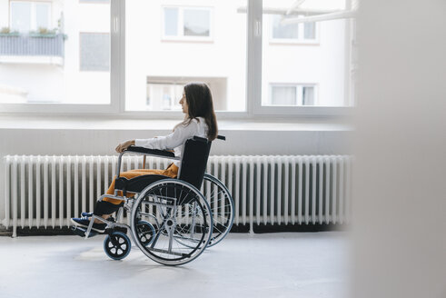 Young handicapped woman sitting in wheelchair - KNSF03946