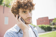 Man using cellular phone outdoors - CUF22817