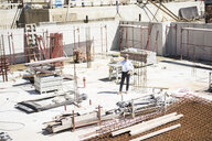 Man on cell phone on construction site - MOEF01309