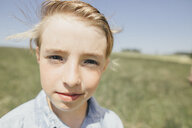 Portrait of confident boy outdoors - KMKF00297