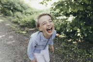 Laughing boy on forest path - KMKF00327