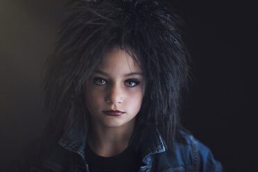 Portrait of girl dressed up as punk looking at camera - ISF08989