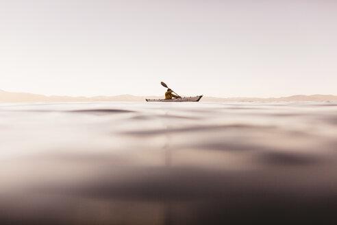 Woman kayaking on Lake Tahoe, California, USA - ISF09137