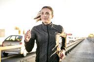 Portrait of sportive woman jogging - MMIF00128