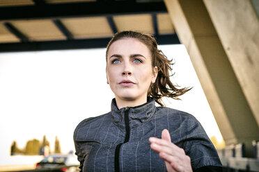 Portrait of sportive woman jogging - MMIF00131