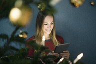 Portrait of smiling woman using tablet at Christmas time - MOEF01371