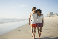 Romantic young couple strolling on beach, Cape Town, Western Cape, South Africa - CUF23195