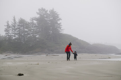 Mother and son walking on beach, Long Beach, Vancouver Island, British Columbia, Canada - CUF23240