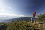 Hiker enjoying view from hilltop, Montseny, Barcelona, Catalonia, Spain - CUF23294