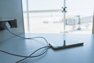 Charging smartphone at airport - AFVF00618