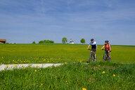 Germany, Upper Bavaria, Schalchen, Chiemgau, cyclists - LBF01950