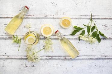Homemade elderflower sirup, lemon slices, leaves and elderflower - LVF07040