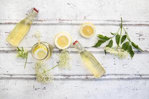 Homemade elderflower sirup, lemon slices, leaves and elderflower - LVF07040