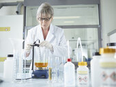 Female chemist working in chemical laboratory - CVF00717