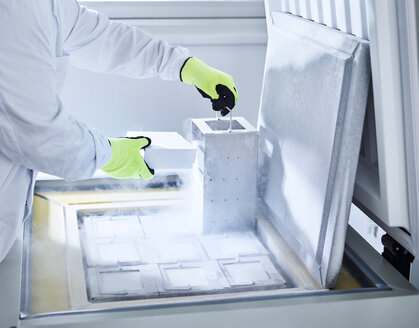 Chemist open upright freezer with gloves - CVF00726