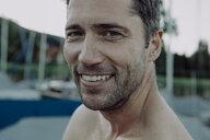 Portrait of smiling man at marina - JLOF00047