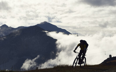 Mountain biker in mountains, Valais, Switzerland - CUF23889