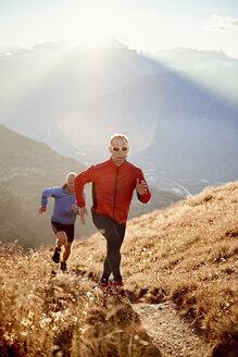 Trail runners on dirt track, Valais, Switzerland - CUF23901