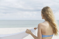 Young blond woman looking out to sea from Miami Beach, Florida, USA - CUF24063