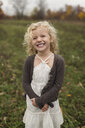 Portrait of young girl smiling, outdoors - CUF24279
