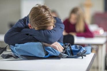 Teenage boy sleeping in class - ZEF15672