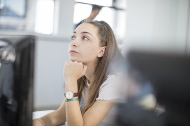 Teenage girl day dreaming in computer class - ZEF15702