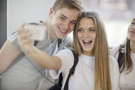 Happy students taking a selfie in school - ZEF15708