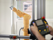 Hand-held control and robot arm - CVF00731
