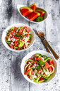 Two bowls of salad with watermelon, cucumber, feta and mint - SARF03767
