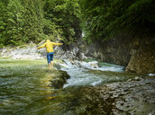 Austria, Tyrol, Brandenberg, man crossing Brandenberger Ache - CVF00734