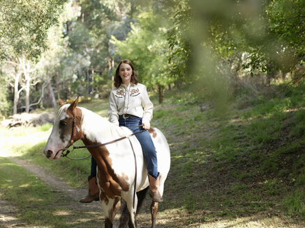 Portrait of teenage girl bareback riding horse - CUF25048