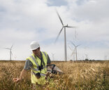 Ecologist inspecting wildlife on windfarm - CUF25522