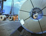 Rolls of steel being loaded in port, Grimsby, England, United Kingdom - CUF25600