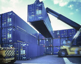 Stacker moving shipping container in port, Grimsby, England, United Kingdom - CUF25609