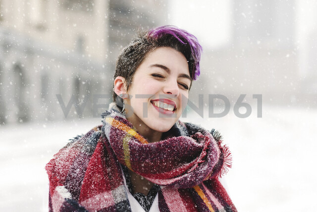 Portrait of young woman standing in front of the Christian Science Centre and Prudential building with snow, Boston, Massachusetts, USA - ISF09454