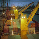 Container ship in port at night - CUF25755