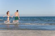 Couple walking in sea - CUF25999