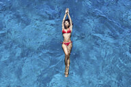 Young woman floating in sea - CUF26017